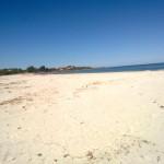 cielo azzurro, mare incontaminato, spiaggia dei confetti